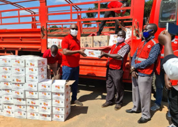 The Coca cola team led by Newton Lee Ogong, Events and Promotions Manager during the handover to Mukono Red Cross Society Manager Sam Mugisha