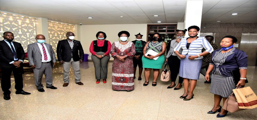 Speaker Rebecca Kadaga (C), Hon. Lyandro Komakech (3rd, Left) after meetng the LASPNET delegation over the Legal Aid Bill in Parliament