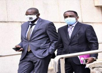The Attorney General, William Byaruhanga (R) and his deputy, Jackson Kafuuzi