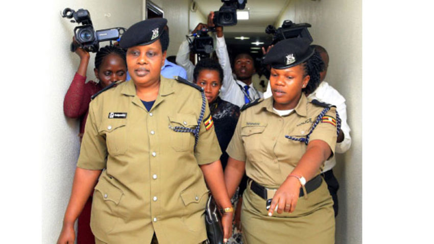 Superintendent of Police in charge of Police Mineral Protection Unit Jessica Keigomba (left) being escorted out of Parliament last year after being quizzed by MPs