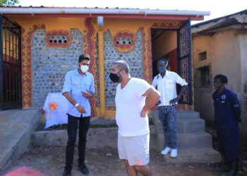 Rajiv Ruparelia inspects one of the eco toilets in Kamwokya