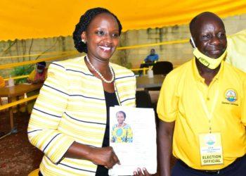 Musherure stands alongside NRM Electoral Commission boss Tanga Odoi