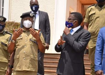 Police Chief Political Commissar AIGP Asan Kasingye with Buganda Kingdom Premier Charles Peter Mayiga
