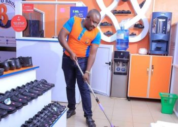 Yesigye Brian in his shop in Kampala