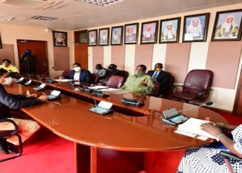 Speaker Kadaga(R) in a meeting with the directors of the sugar companies