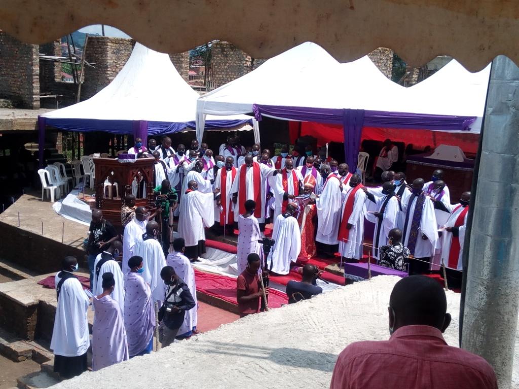 Rev Benon Magezi ordaining priests last year