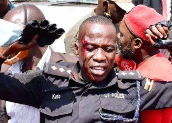 Injured Afande Kato, the head of Bobi Wine police security detail being taken to hospital