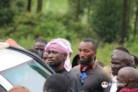 Bobi Wine and behind him is Norbert Elber Ariho