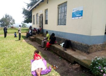 Patients waiting for health workers outside katete health center III building. photo by Ronald Kabanza.