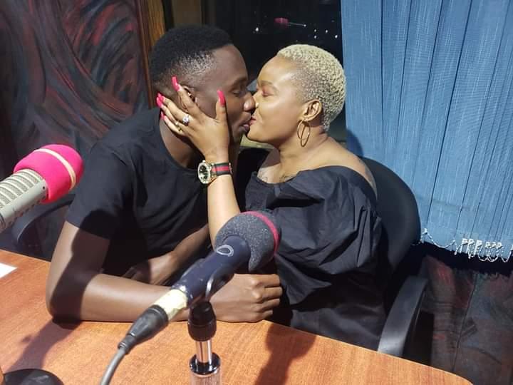 Don Zella kissing Tamale Mirundi's son