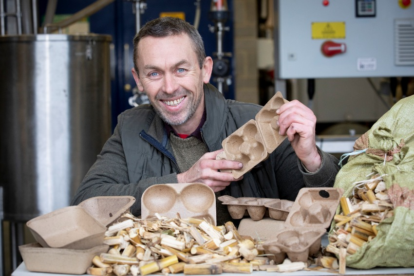 Llion Williams, Chief Technician at Bangor University's BioComposites Centre, with the new packaging and the maize stover it is made from
