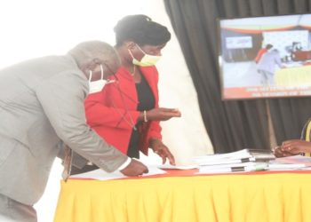 MPs consulting with a Parliament official during the plenary on Thursday in which the Leadership Code Bill was passed
