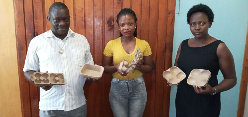 The team from Makerere University with samples of the Stoverpack packaging, from left, Dr. Stephen Lwasa, Leticia Katiiti and Grace Mbabazi