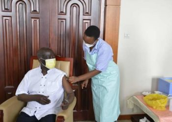VP Ssekandi receiving his Covid-19 vaccine jab