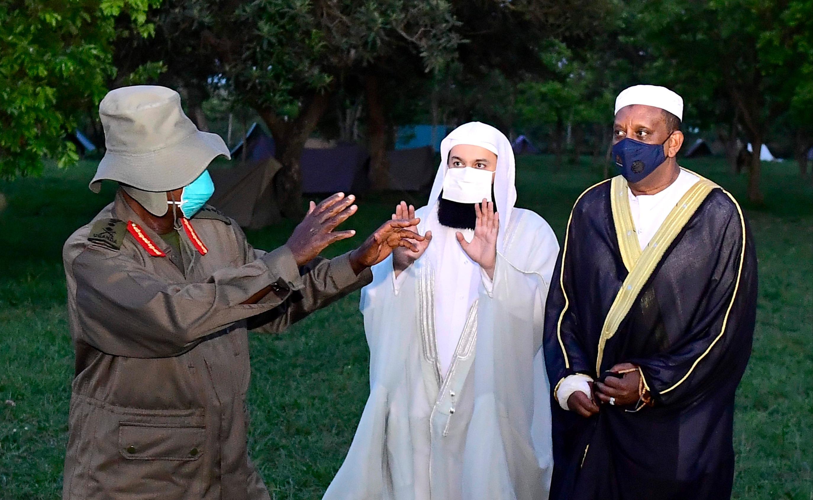 President Museveni and Sheikh Menk (middle) at Kyankwanzi State Lodge on Tuesday