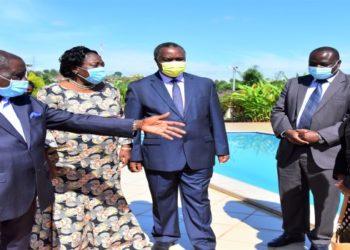 AGTs Njuki Nsubuga (L) receiving Speaker Rebecca Kadaga (2L) and Minister Elioda Tumwesigye (C) at the laboratory premises in Mukono district
