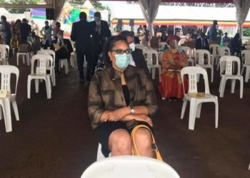 US Ambassador to Uganda Natalie Brown seated in a plastic chair at Museveni's swearing-in ceremony