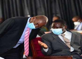 The chair of the Budget Committee, Hon Lugoloobi(L) withthe State Minister for finance, Hon Bahati during the debate on the budget