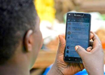 A smartphone user in Uganda