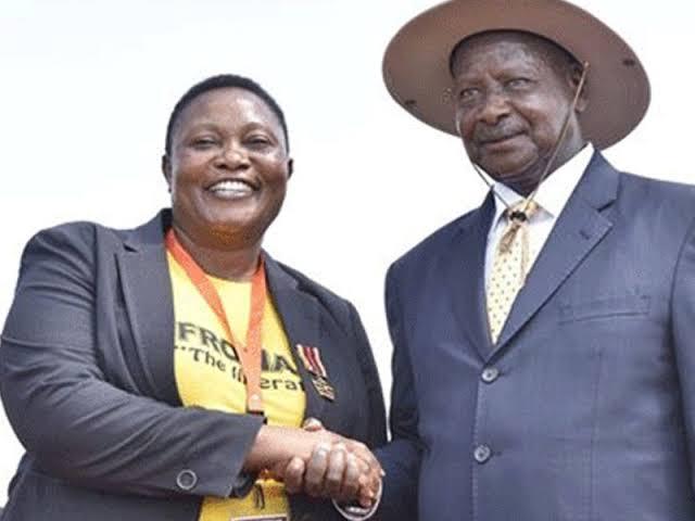 Milly Babalanda with President Museveni