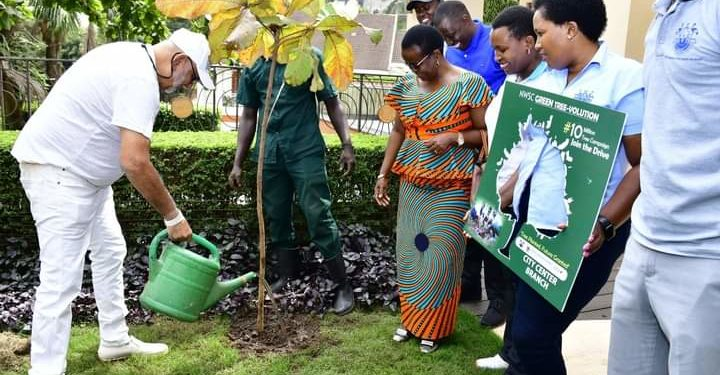 Dr Sudhir plants a tree at his home in Kololo