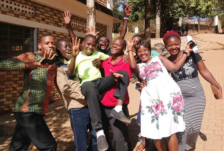 Candidates jubilating after passing PLE exams in 2019