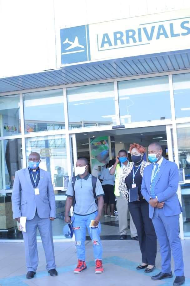 Ssekitoleko with officials from Ministry of Foreign Affairs and Ministry of Education and Sports at Entebbe Airport on Friday