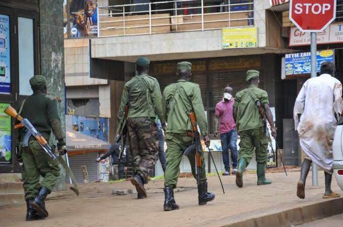 Security officers enforcing Covid-19 directives in Kampala