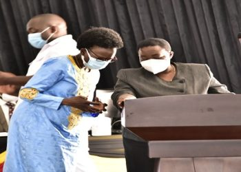The Premier, Hon Nabbanja with the Health Minister, Ruth Aceng during the sitting of the House