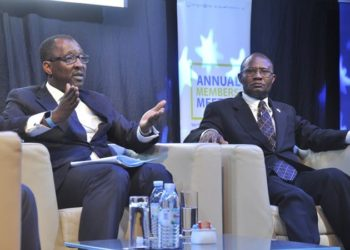 Richard Byarugaba (L) the NSSF Managing Director with Patrick Byabakama Kaberenge the Board Chairman.