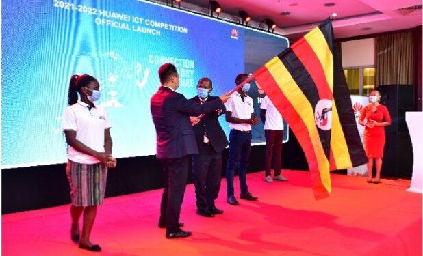 Hon JC Muyingo handing over the flag to Huawei MD Mr. Gaofei