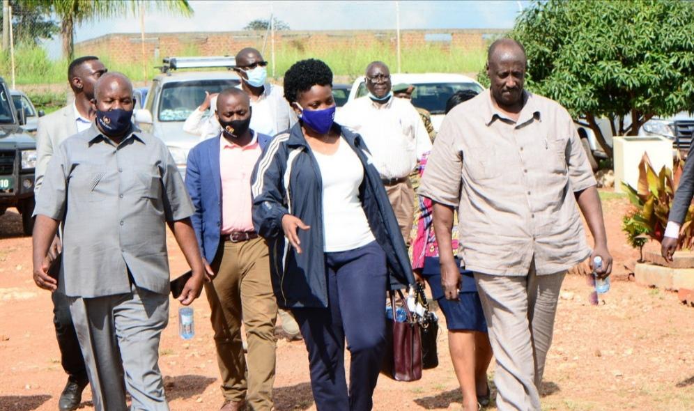 Lands Minister Judith Nabakooba with OWC Chief Coordinator Gen Salim Saleh at Purongo Grain Hub in Nwoya District.