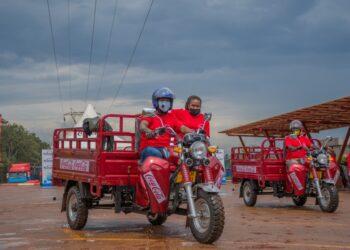 Winners test driving the Tuk-Tuks at Coca-Cola Namanve