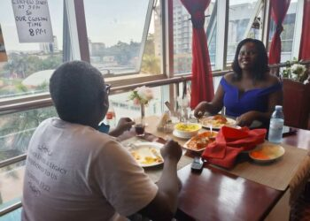 Nantongo with her ex husband having a meal