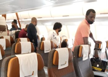 Some of the passengers who took a flight to Dar es Salaam using Uganda Airlines' new Airbus