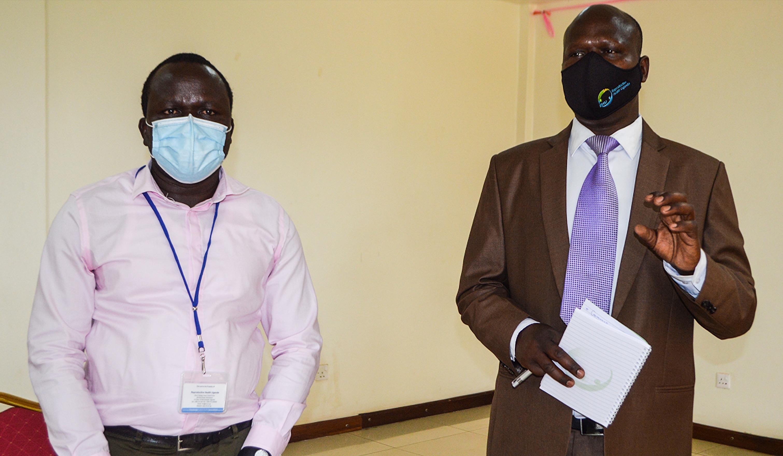 L-R Robert Ocaya RHRN - RHU Coordinator and Jackson Chekweko ED RHU at Mbale Kayegi Hotel