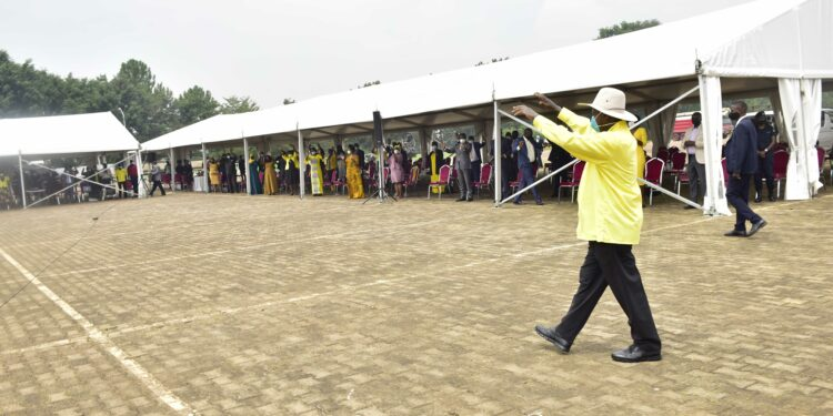 President Yoweri Museveni waving at the NRM party members that were attending the NRM Caucus meeting at the Independence Memorial Grounds Kololo on September 28, 2021. Photo by PPU/ Tony Rujuta.