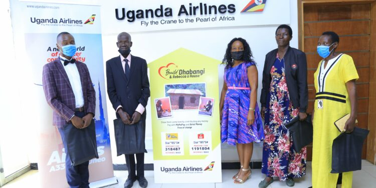 Henry, Dhabangi, Airline's Doreen, Maama Rebecca and Henry's mother at Uganda Airlines Offices on Thursday