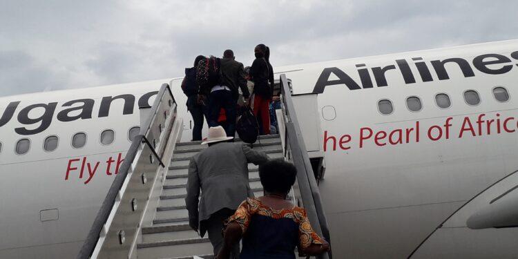 Passengers boarding Uganda Airlines Airbus
