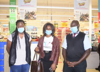 """(L-R) : Gonzaga Kajja; Deputy Manager, Carrefour Naalya at Metroplex Mall with Sylivia Namagembe, Headteacher Kireka Home for the Children with Special Needs and her deputy; Gertrude Lyaka at the launch of the """"Round Up you Bill"""" campaign."""