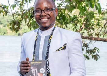 Growth Coach Ngonzi Wataba posing with his recently published book