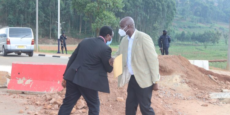 Rwanda official Felix Ndayambaje and Kabale district chairperson Nelson Nshangabasheija