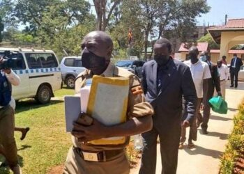 Businessman Francis Onebe (in black suit) remanded to Kitalya Prison