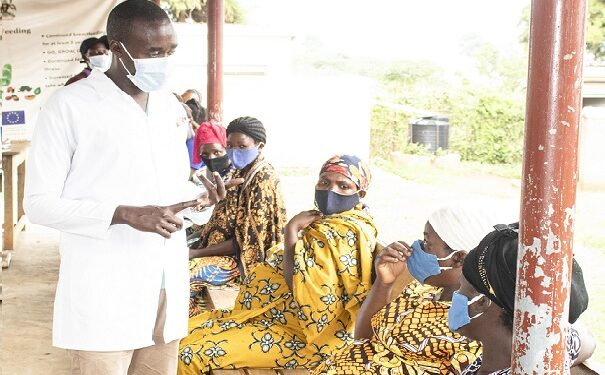 Paul Kayibire counsels pregnant women about involving their husbands in sexual reproductive health and rights at Rwenyawawa health Centre III