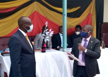 Former Rubanda CAO Christopher Ahimbisibwe (Right) with Rubanda District LC.5 Chairperson Stephen Kasyaba