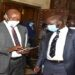 State Minister for Finance, Hon Lugoloobi(L) with Hon Ssekikubo after adjournment of the plenary sitting