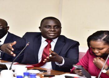 Muwanga Kivumbi (C) makes his presentation before the Budget Committee